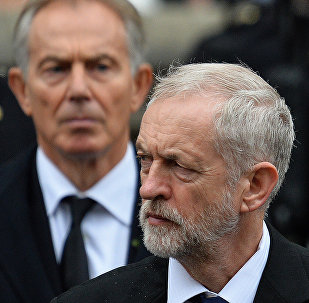 British opposition Labour party leader Jeremy Corbyn (R) and former British Prime Minister Tony Blair attend the Remembrance Sunday ceremony at the Cenotaph on Whitehall, London, on November 8, 2015.