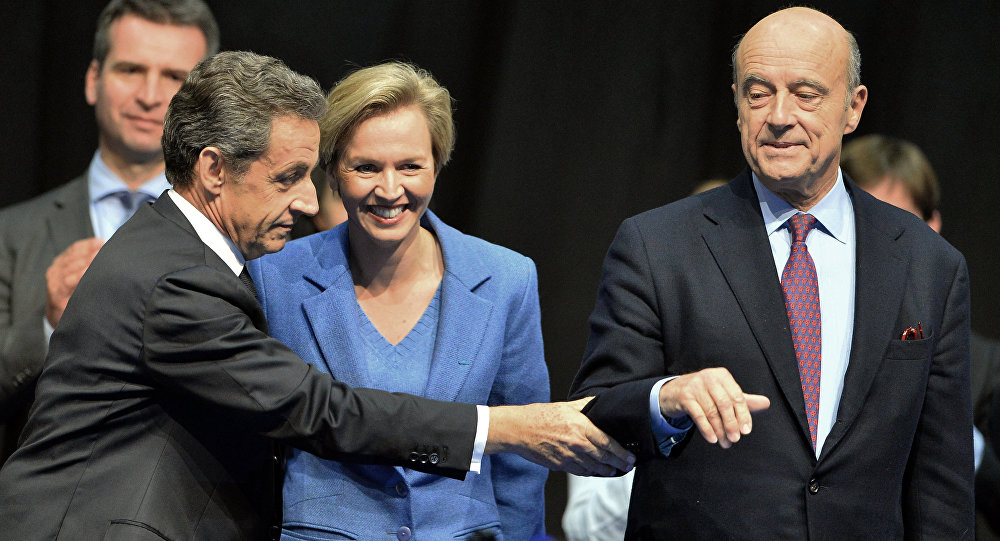 Former French President and French right-wing Les Republicains (LR) party President Nicolas Sarkozy (L) touches mayor of Bordeaux Alain Juppe (R) (File)