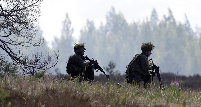 Polish army soldiers take part in the Saber Strike NATO military exercise in Adazi, Latvia, June 13, 2016.