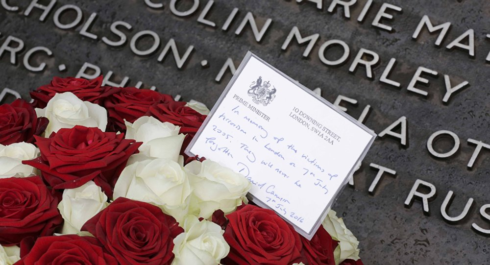 Flowers from British Prime Minister David Cameron are displayed at the memorial to the victims of the July 7, 2005 London bombings, in Hyde Park, London.