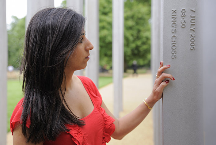 Saba Mozakka, whose mother Behnaz Mozakka was killed in the London terrorist attacks on July 7, 2005, places her hand on a memorial dedicated to the London Bombing victims, in Hyde Park, central London, on July 6, 2009.