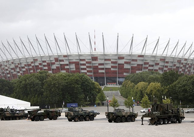 Armoured military vehicles are parked outside PGE National Stadium, the venue of the NATO Summit, in Warsaw, Poland July 8, 2016.