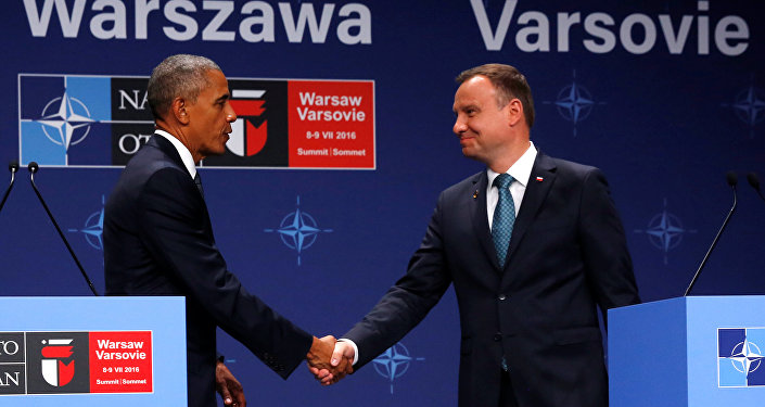 U.S. President Barack Obama and Poland's President Andrzej Duda shake hands after remarks to reporters after their meeting at the NATO Summit in Warsaw, Poland July 8, 2016.