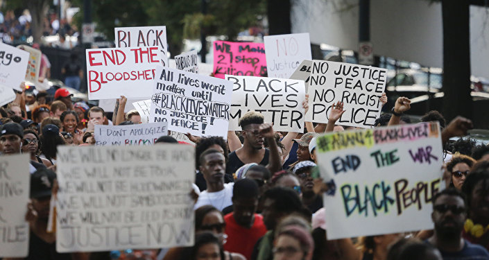 Demonstrators march through downtown Atlanta to protest the shootings of two black men by police officers, Friday, July 8, 2016.