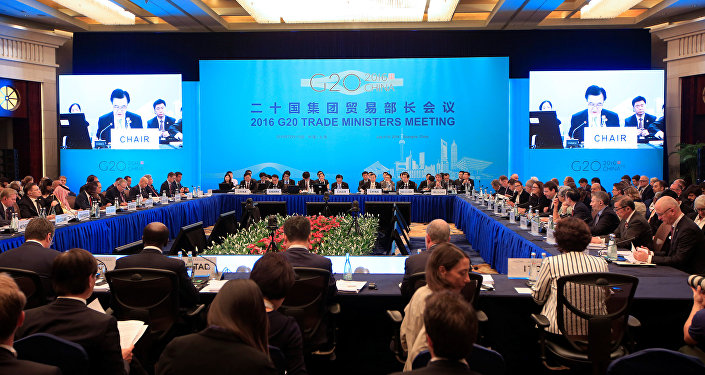 Attendees listen to a speech by China's Commerce Minister Gao Hucheng during the opening ceremony of the 2016 G20 Trade Ministers Meeting in Shanghai, China July 9, 2016.