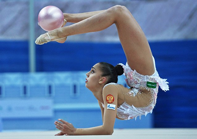 Russia's Margarita Mamun performs a ball routine during individual all-around at the 2016 Rhythmic Gymnastics World Cup Series in Kazan, Russia