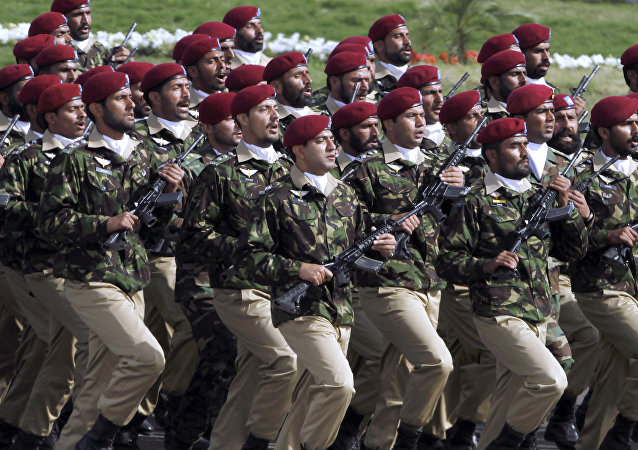 Pakistani commandos from the Special Services Group march during a military parade