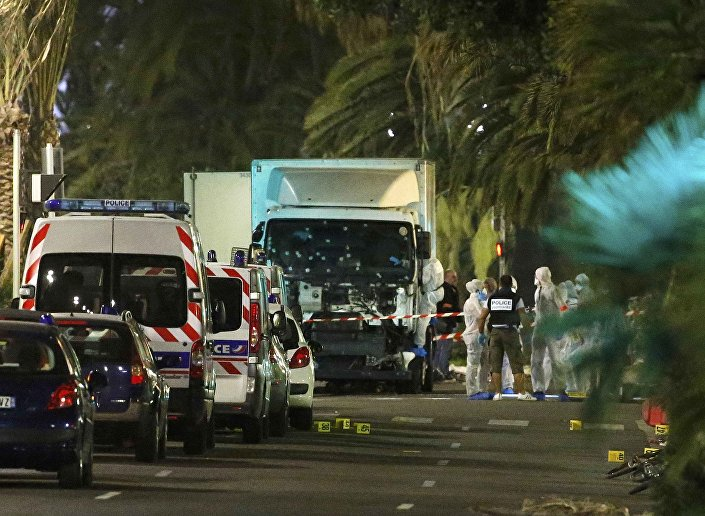 French police forces and forensic officers stand next to a truck July 15, 2016 that ran into a crowd celebrating the Bastille Day national holiday on the Promenade des Anglais in Nice, France, July 14