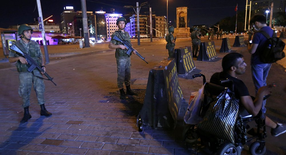 Turkish military stand guard near the the Taksim Square in Istanbul.