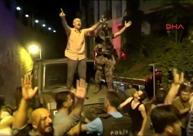 Still Frame Taken From Video Shows A Soldier And A Man On A Military Vehicle trying to calm AK Party Supporters During An Attempted Coup In Istanbul