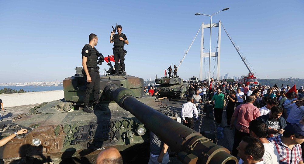 Policemen stand on a military vehicle after troops involved in the coup surrendered on the Bosphorus Bridge in Istanbul, Turkey July 16, 2016.