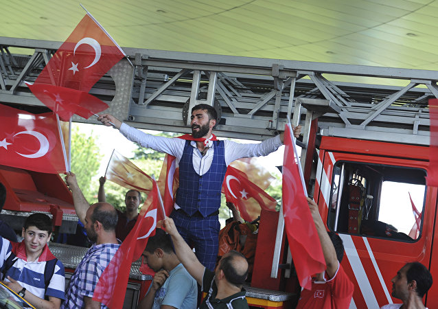 People against the attempted coup celebrate at Istanbul's Ataturk airport, Saturday, July 16, 2016.