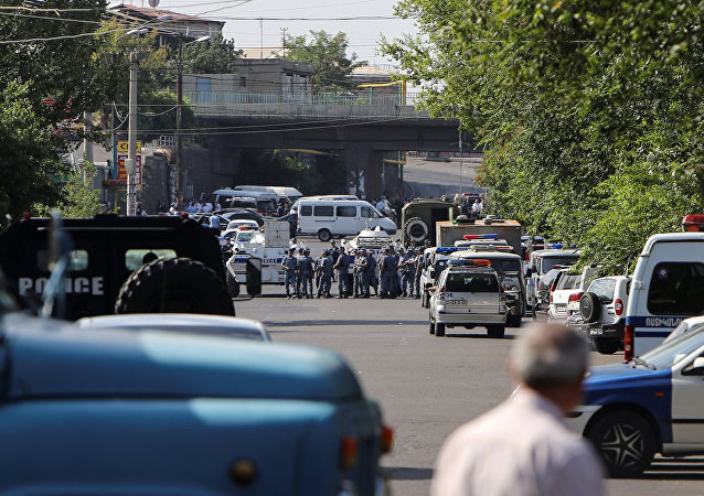 Policemen block a street after group of armed men seized a police station along with an unknown number of hostages, according the country's security service, in Yerevan, Armenia, July 17, 2016.