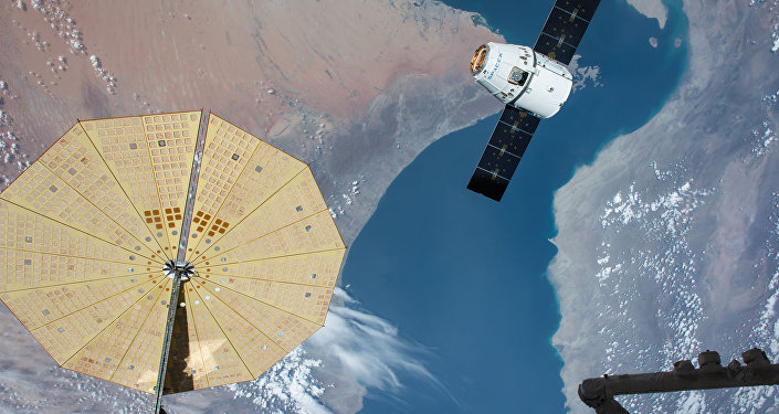 The SpaceX Dragon spacecraft nears the International Space Station during the CRS-8 mission to deliver experiments including two microbial investigations.
