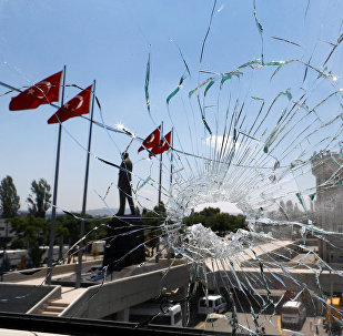 A damaged window is pictured at the police headquarters in Ankara, Turkey, July 18, 2016