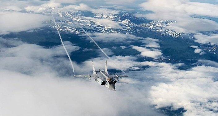 Mig-31 Foxhound supersonic interceptor of the Russian Pacific Fleet performs midair refuelling.