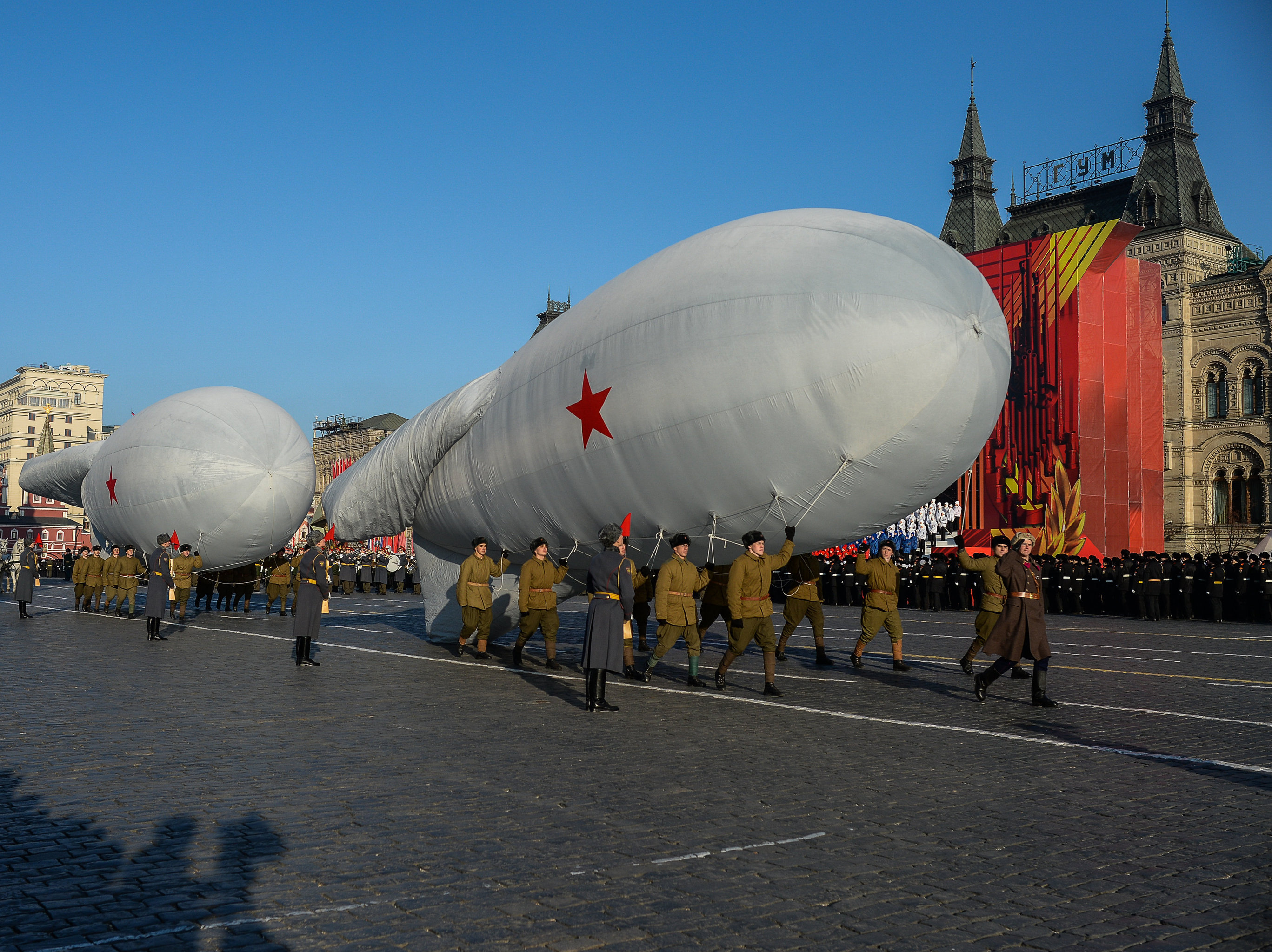 Servicemen marching with mock blimps to mark the legendary November 7, 1941 Military Parade on Red Square, Moscow.