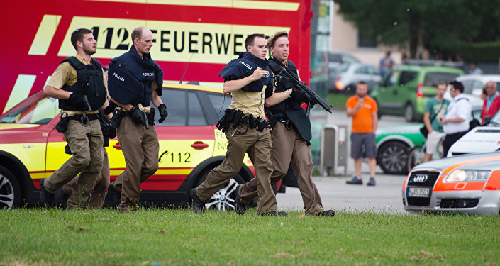 Police walks near a shopping mall amid a shooting on July 22, 2016 in Munich