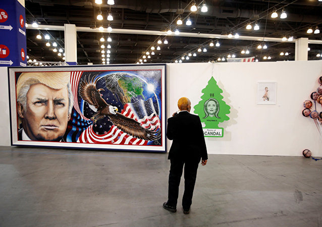 A security guard stands in front of artwork depicting Presidential candidates including Donald Trump, Hillary Clinton, and Rick Perry during the Politicon convention in Pasadena, California, U.S. June 25, 2016