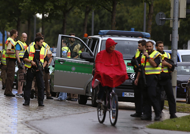 Police secure a street near to the scene of a shooting in Munich, Germany July 22, 2016