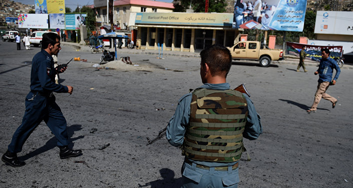 Afghan security personnel arrive after a suicide attack that targeted crowds of minority Shiite Hazaras during a demonstration at the Deh Mazang Circle of Kabul on July 23, 2016.