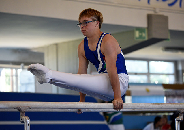 A gymnast competes on the parallel bars in Florence on July 18, 2016, during the first World Trisome Games, dedicated exclusively to athletes with Down syndrome.