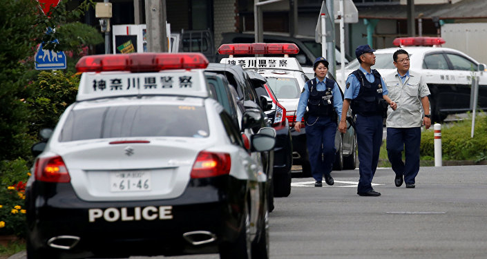 Police officers investigate near a facility for the disabled, where a deadly attack by a knife-wielding man took place, in Sagamihara, Kanagawa prefecture, Japan, July 26, 2016.