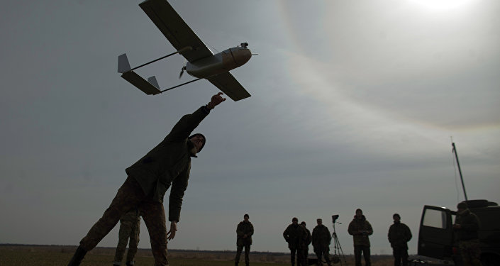 A serviceman launches an unmanned reconnaissance aircraft at the position of the Ukrainian forces near eastern Ukrainian city of Lysychansk, Lugansk region on March 24, 2015