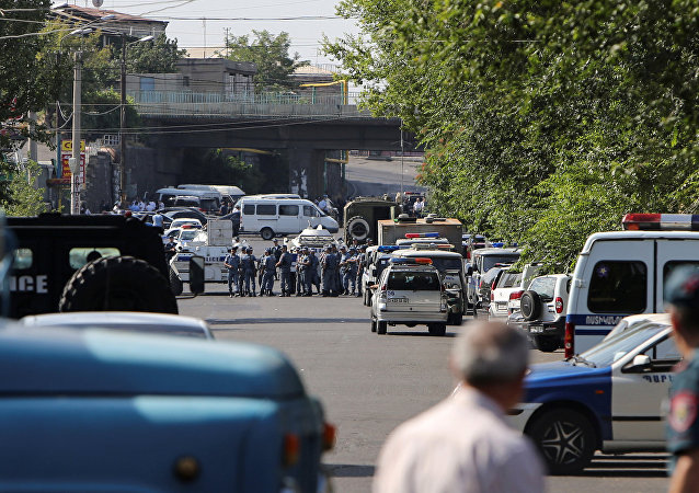 Policemen block a street after group of armed men seized a police station along with an unknown number of hostages, according the country's security service, in Yerevan, Armenia