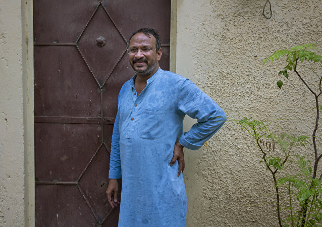 India's Bezwada Wilson, who is among the six recipients of this year's Ramon Magsaysay Award, waits to enter the Safai Karmachari Andolan (SKA) office in New Delhi, India, Wednesday, July 27, 2016