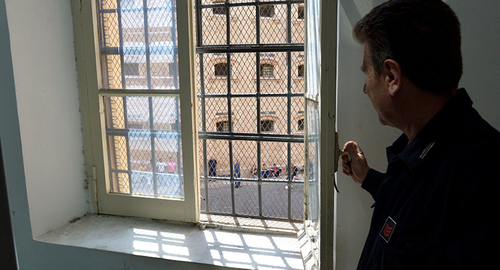 A guard looks at prisoner from a window of Regina Coeli prison in Rome on May 30, 2014