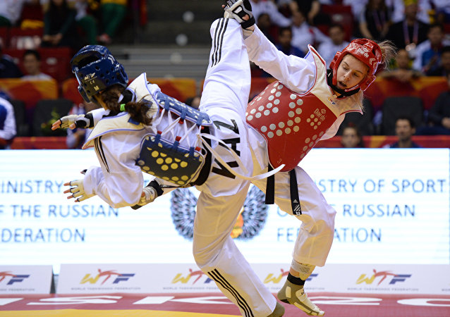 From left: Gulim Bibalayeva (Kazakhstan) and Darya Adamiak (Russia) during the women's competition in the 62 kg division at the World Taekwondo Championships in Chelyabinsk