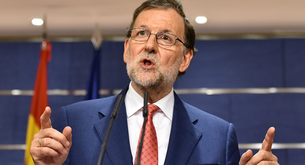 Spain's interim Prime Minister Mariano Rajoy gives a press conference at the Spanish parliament in Madrid