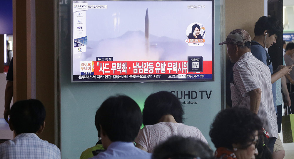 South Koreans watch a TV news program airing file footage of a North Korean rocket launch at the Seoul Railway Station in Seoul, South Korea, Wednesday, Aug. 3, 2016.