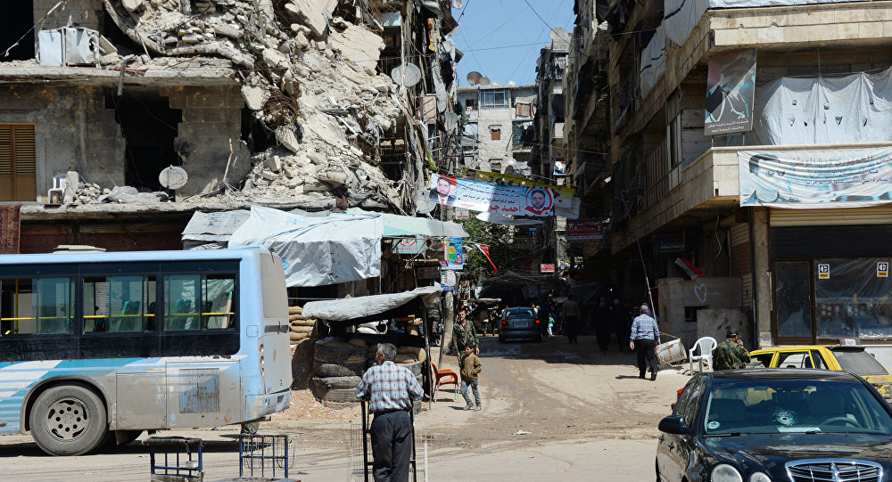 Local citizens continue to live in destroyed buildings in the Salah ad-Din District in Aleppo.