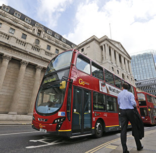 A London bus passes the Bank of England in London, Thursday, Aug. 4, 2016
