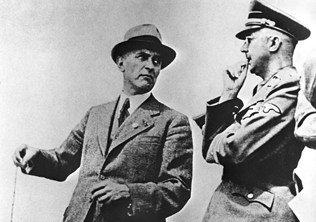 IG Farbenindustrie chief engineer M. Faust (L) talks with Reichsfuhrer of the SS Heinrich Himmler (R).