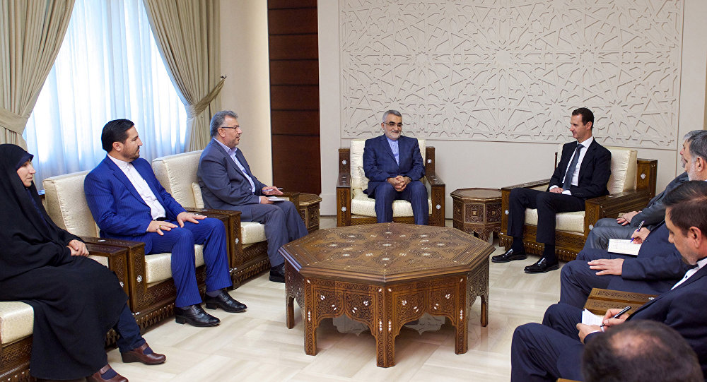 Syria's President Bashar al-Assad meets with Chairman of the Iranian parliament's National Security and Foreign Policy Commission, Alaeddin Boroujerdi (C-L),in this handout picture provided by SANA on August 4, 2016