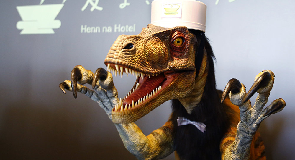 In this July 15, 2015 photo, a receptionist dinosaur robot performs at the new robot hotel, aptly called Henn na Hotel or Weird Hotel, in Sasebo, southwestern Japan