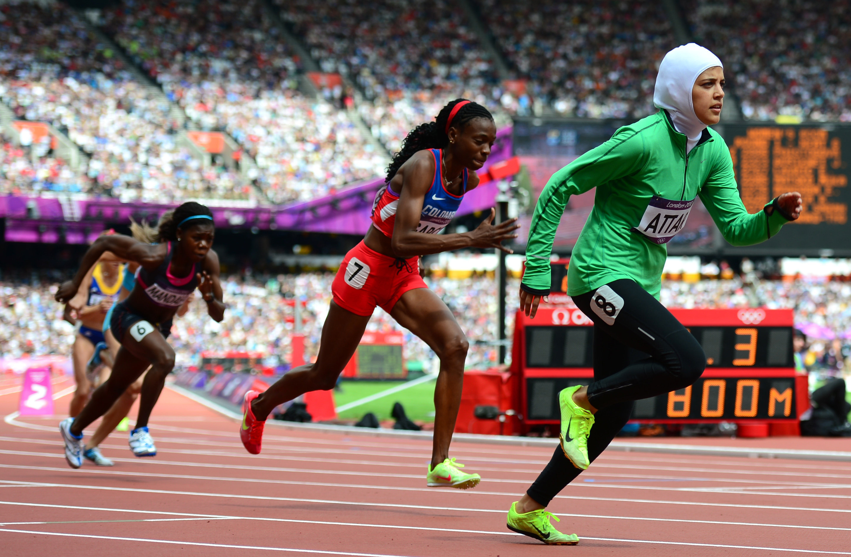 This file photo taken on August 8, 2012 shows (from L) Central Africa Republic's Elisabeth Mandaba, Colombia's Rosibel García and Saudi Arabia's Sarah al-Attar competing in the women's 800m heats at the athletics event of the London 2012 Olympic Games in the capital
