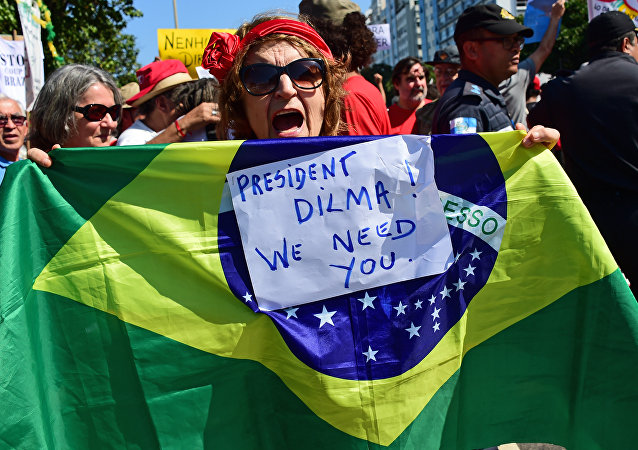 Residents of Rio de Janeiro demonstrate against interim president Michel Temer, political upheaval, corruption and the cost of the Rio 2016 Olympics Games, in front of the Copacabana Palace Hotel on August 5, 2016