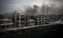 In this Tuesday, Oct. 2, 2012 file photo, smoke rises over Saif Al Dawla district, in Aleppo, Syria