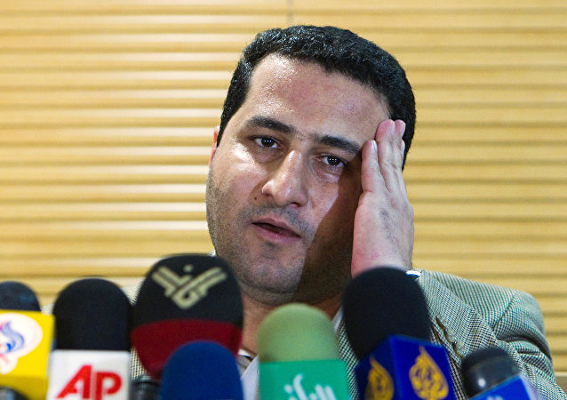 Iranian scientist Shahram Amiri speaks to journalists as he arrives at the Imam Khomini Airport in Tehran, July 15, 2010