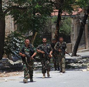 Syrian army soldiers patrol a street in government-controlled Aleppo's al-Khalidiya area (File)
