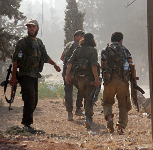 Fighters from the former Al-Nusra Front -- renamed Fateh al-Sham Front after breaking from Al-Qaeda -- advance at an armament school after they announced they seiged control of two military academies and a third military position on August 6, 2016, the Syrian Observatory for Human Rights said