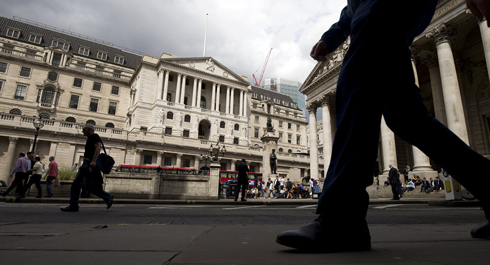 People walk past the Bank of England in central London on August 3, 2016