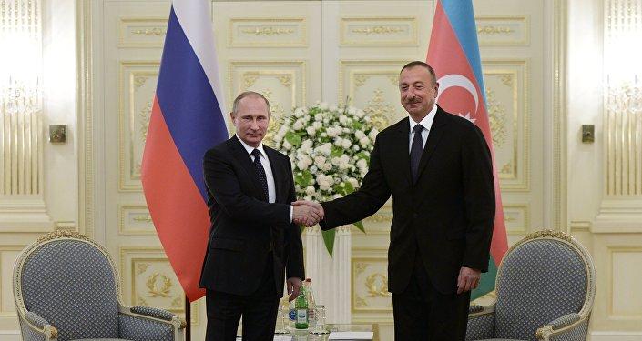 Russian President Vladimir Putin, left, and President of Azerbaijan Ilham Aliyev during a meeting at Genclik residence in Baku
