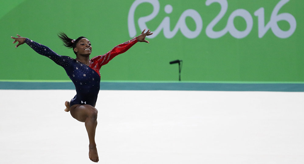 US gymnast Simone Biles competes in the qualifying for the women's Floor event of the Artistic Gymnastics at the Olympic Arena during the Rio 2016 Olympic Games in Rio de Janeiro on August 7, 2016.