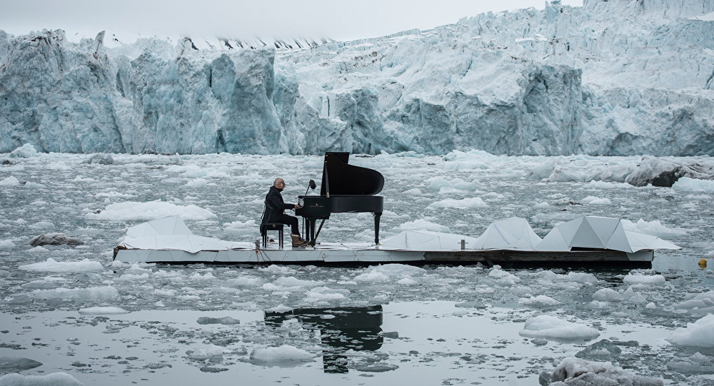 Composer Ludovico Einaudi performing on a platform in the Arctic Ocean, 2016