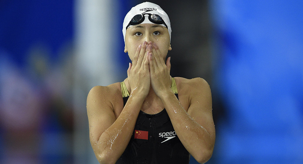 China's Chen Xinyi reacts after winning the final of the women's 50m freestyle swimming event during the 17th Asian Games at the Munhak Park Tae-hwan Aquatics Centre in Incheon on September 26, 2014